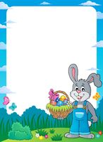 Frame with bunny holding Easter basket