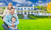 Mixed Race Family In Front Yard of Beautiful House and Property.