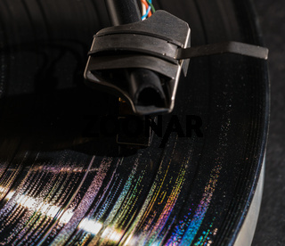 Rainbow reflections in grooves of long playing vinyl record