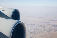 Airliner jet engines and desert landscape