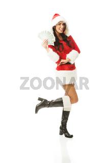 Full length beautiful santa woman holding a clip of polish money