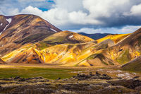 Multicolored rhyolite mountains and the July sun