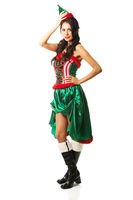 Full length woman wearing elf clothes, touching her head and hip