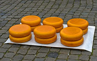 cheese wheels piled up on the cheese market, Gouda, Netherlands