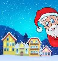 Winter village with lurking Santa Claus