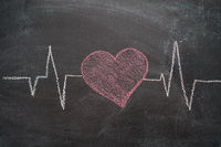 Heartbeat character and design on black chalkboard