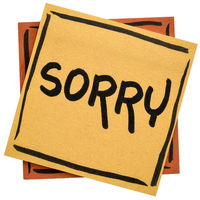 sorry - apology on sticky note