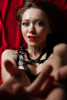 Submissive woman in leather bdsm fetish lingerie