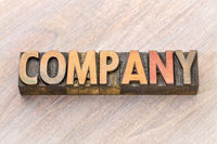 company word abstract in wood type