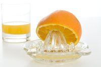 Orange und Entsafter