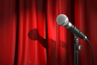 Microphone on stage with red curtain. Music or performance  concept.