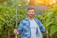 Gardener watering plants