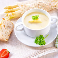 asparagus cream soup with capers and fresh baguette
