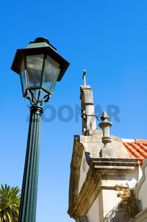 The antique lantern (street lamp) and  residential house