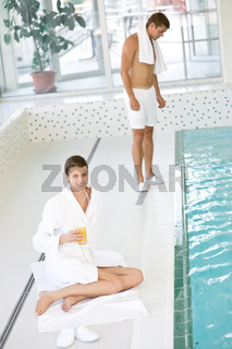 Swimming pool - young happy couple relax