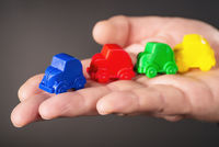 Small toy cars on a hand