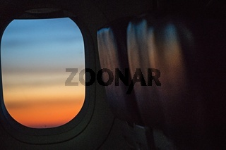 colorful sunrise in airplane window