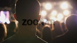 Man listens the rock concert in stadium