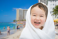Happy Cute Mixed Race Chinese and Caucasian Boy On Waikiki Beach, Hawaii Wrapped In A Towel