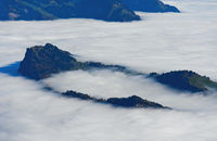 Bürgenstück mountain range rises from the sea of fog over Lake Lucerne, near Lucerne,Switzerland