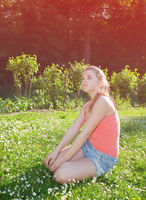 young girl sitting on grass