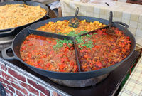 Fast street food - stewed haricot, paprika, tomato sauce  and potato with boiled beef in big frying pan.