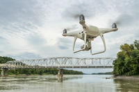 Phantom quadcopter drone flying over river