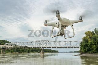 Phantom quadcopter drone flying over river