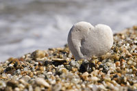 little white stone heart on a beach, Sardegna