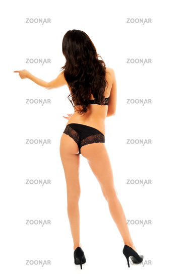 Sexy brunette woman pointing left