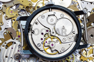 open old mechanical watch on pile of spare parts