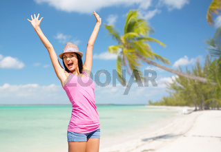 happy young woman in hat on summer beach