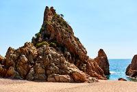 Rocky seaside of Mar Menuda Beach in Tossa de Mar. Costa Brava, Spain
