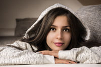 Cheerful brunette woman in a cozy ambience