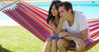 Affectionate young couple sitting on a hammock