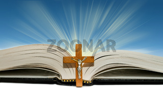 Open book and a cross