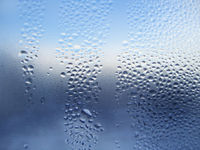 Natural water drops on glass