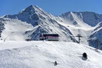 Upper station of the chairlift Wurzenbord against the peak Bättlihorn, skiing area Aletscharena,