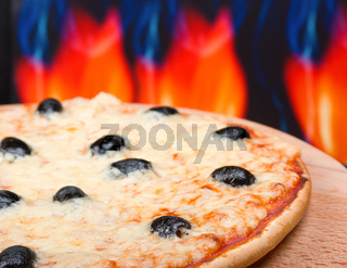 Pizza  with fire on background