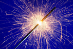 sparkler against blue background.