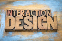 interaction design word abstract in wood type