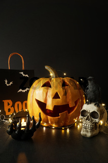 Large wooden pumpkin with lights and candle
