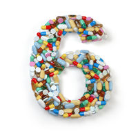 Number 6 six. Set of alphabet of medicine pills, capsules, tablets and blisters isolated on white.