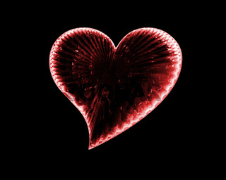 red icy heart in the dark