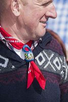 Man wearing wooden Dutch shawl pin, Alkmaar, Netherlands