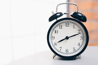 Retro alarm clock on table