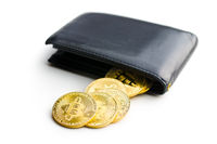 Golden bitcoins in leather wallet.