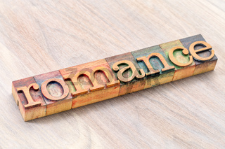 romance word typography in wood type
