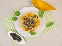 Appetizer with millet, red kuri squash and pumpkin seeds