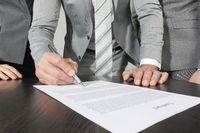 Business people sign contract